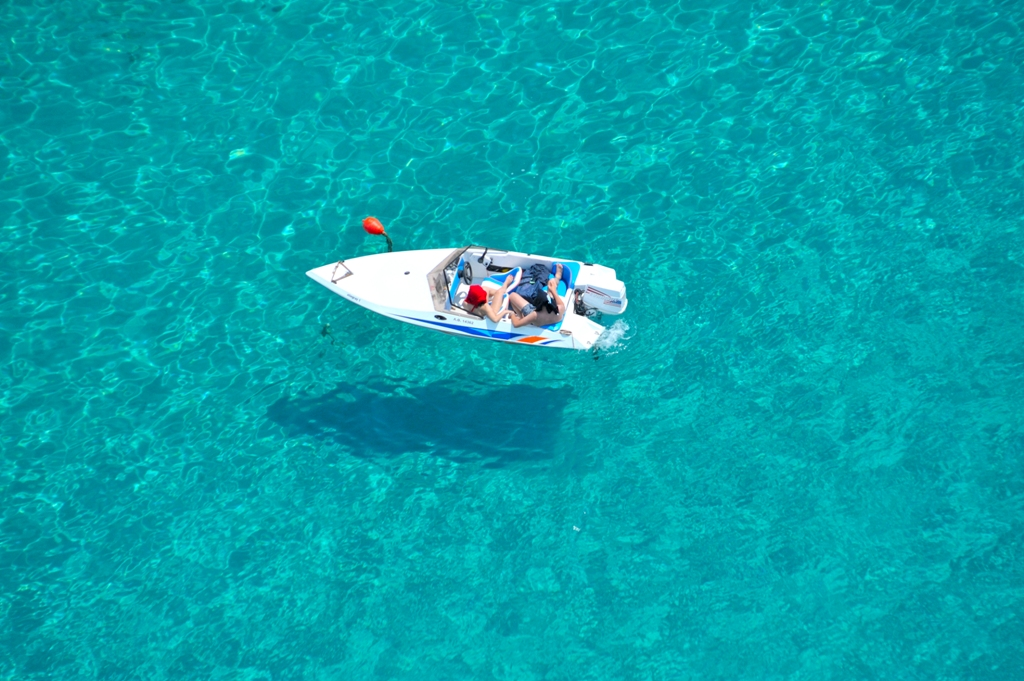 Boat on crystal clear waters